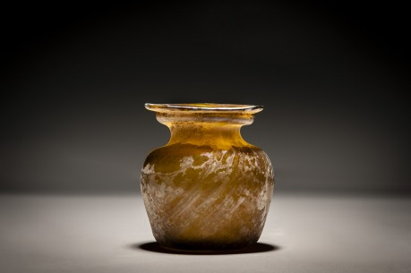 A Roman Amber Glass Jar with Diagonal Ribbing
