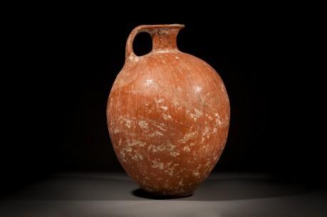 A Canaanite Large Red Slip Burnished Wine Jug