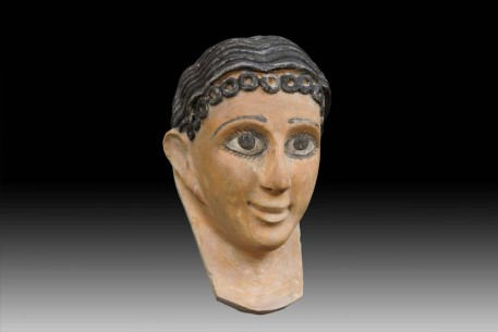 A Fine Egyptian Gypsum Mask of a Young Girl